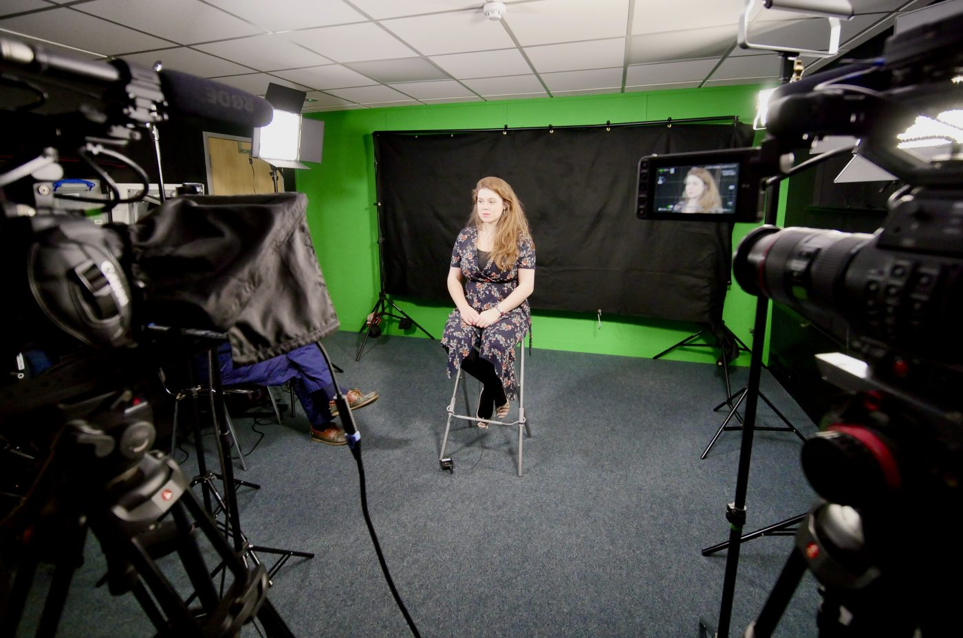 Filming with Family Mental Wealth in our studio. There are two cameras, lights and a backdrop set up.