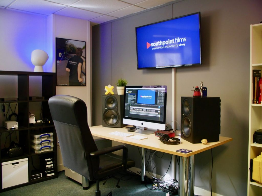 Our new edit suite, with a large television mounted on the wall and studio monitors for audio production