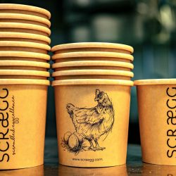 A close-up of the Eurofood Scraegg Pro serving cups