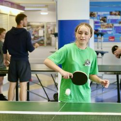 A student plays table tennis